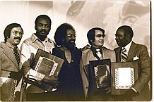 218px-jim_jones_receives_the_martin_luther_king2c_jr-_humanitarian_award_-_january_1977_28229